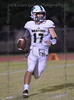 #17 Woodlands Christian QB Josh Johnson runs out of the pocket to try to find an open receiver.