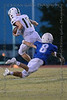 Woodland Christian Academy QB #17 Josh Johnson is tripped up from behind by #8 Trinity Valley DB Tucker Howell.