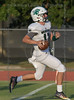The Woodlands Christian Academy QB #17 Josh Johnson crosses the goal line for a touchdown.