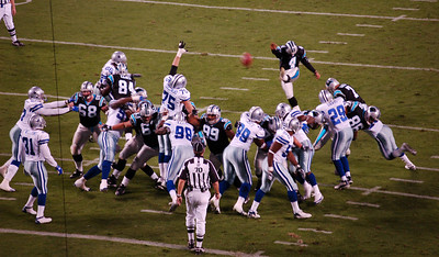 John Kasay boots in teh extra point after the Panthers first touchdown.  http://www.nfl.com/players/playerpage/1379