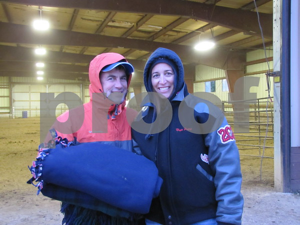 Paul and Sheila Petry are bundled up and ready to watch the Triton Stampede on a cold night at the Webster County Fairgrounds.