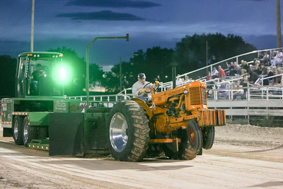 Ken Foland of Sidney drives his 1953 Minneapolis Moline tractor during the Camp Clarke Days Tractor Pull. Foland pulled 251 feet to place first in the exhibition class.