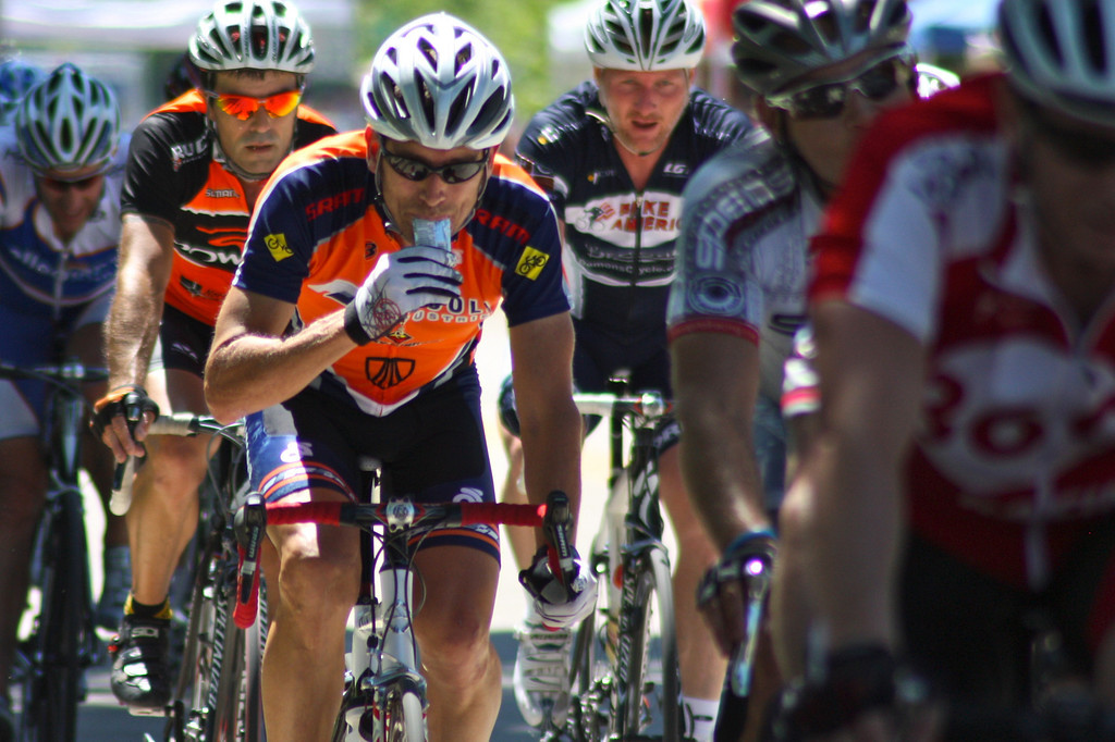 """A racer restores carbohydrates by eating an energy bar during the Men's Cat I/II Race at the 2009 Tulsa Tough Cyclist competition. More deatils at <a href=""""http://blog.rjbphoto.com/2009/06/tulsa-tough.html"""">http://blog.rjbphoto.com/2009/06/tulsa-tough.html</a>"""