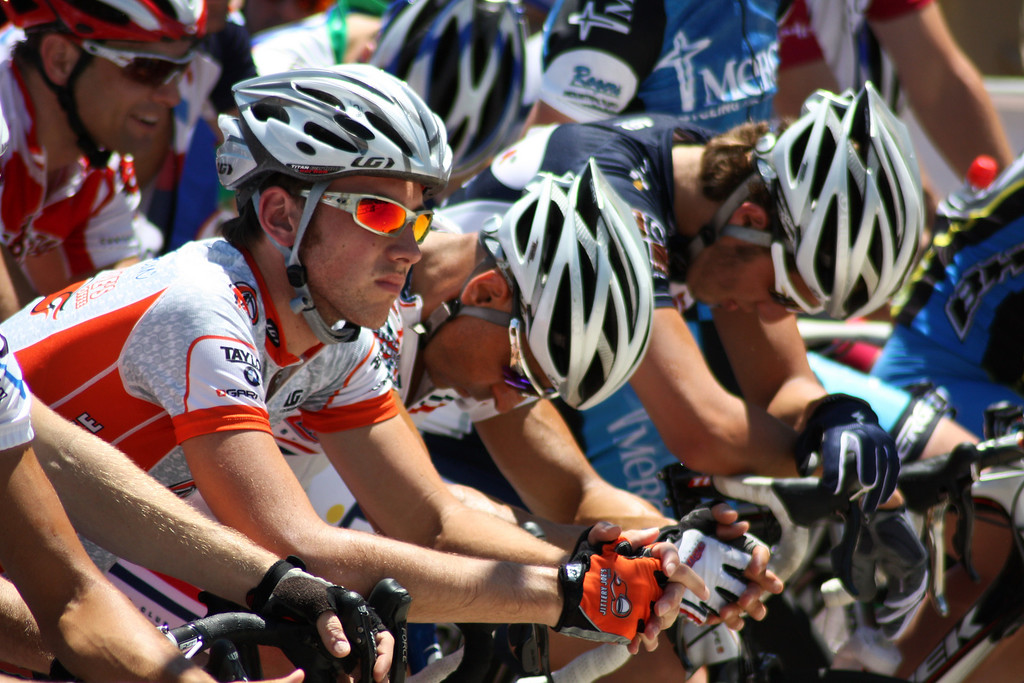 """Male cyclists line up at the starting line for the Men's Pro I race on Sunday at the 2009 Tulsa Tough Competition. More details here: <a href=""""http://blog.rjbphoto.com/2009/06/tulsa-tough.html"""">http://blog.rjbphoto.com/2009/06/tulsa-tough.html</a>"""
