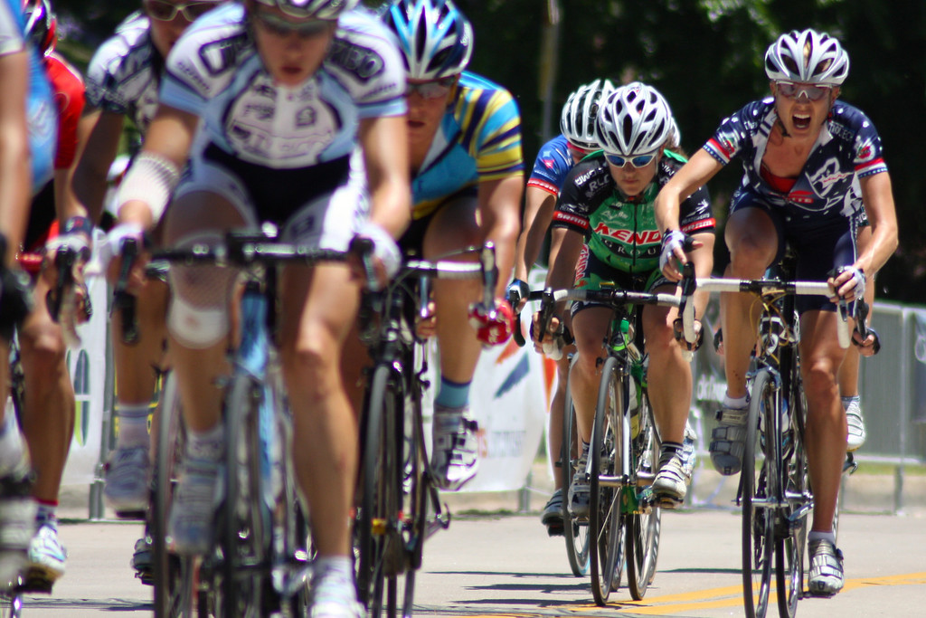 """A cyclist prepares to advance towards the front of the peloton during the Woman's Pro Cat I/II race at the 2009 Tulsa Tough competition. More details: Women corner around the last turn of the riverside drive course at the 2009 Tulsa Tough cycling competition. <a href=""""http://blog.rjbphoto.com/2009/06/tulsa-tough.html"""">http://blog.rjbphoto.com/2009/06/tulsa-tough.html</a>"""