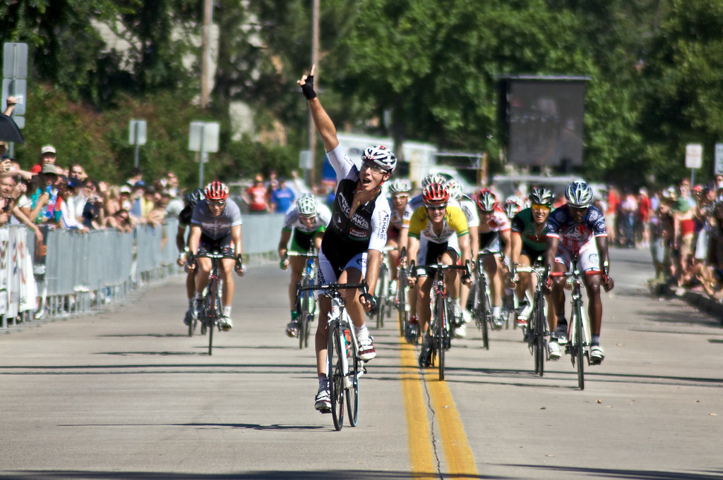 """Daniel Ramsey of Team Successful Living crosses the finish line during the Men's Pro I race at the 2009 Tulsa Tough Competition. More details about the race can be found at <a href=""""http://blog.rjbphoto.com/2009/06/tulsa-tough.html"""">http://blog.rjbphoto.com/2009/06/tulsa-tough.html</a>"""