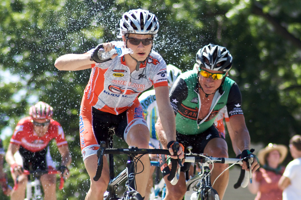 """A member of Jittery Joe's / Team Kudzu splashes water over his face to cool off during the 2009 Tulsa Tough Competition. More details about the race can be found at <a href=""""http://blog.rjbphoto.com/2009/06/tulsa-tough.html"""">http://blog.rjbphoto.com/2009/06/tulsa-tough.html</a>"""