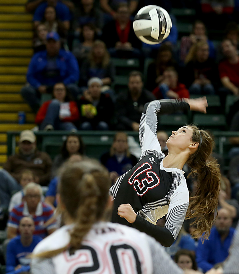 E.L. Hubbard / Special to GateHouse Ohio Media<br /> Zoarville Tuscarawas Valley (H) Kayla Hall returns a volley to Marengo Highland during their Division III semifinal at Wright State's Nutter Center in Fairborn Friday, Nov. 11, 2016.