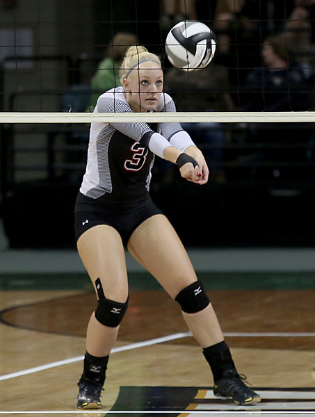 E.L. Hubbard / Special to GateHouse Ohio Media<br /> Zoarville Tuscarawas Valley (B) Clara Ackerman returns a volley to Marengo Highland during their Division III semifinal at Wright State's Nutter Center in Fairborn Friday, Nov. 11, 2016.