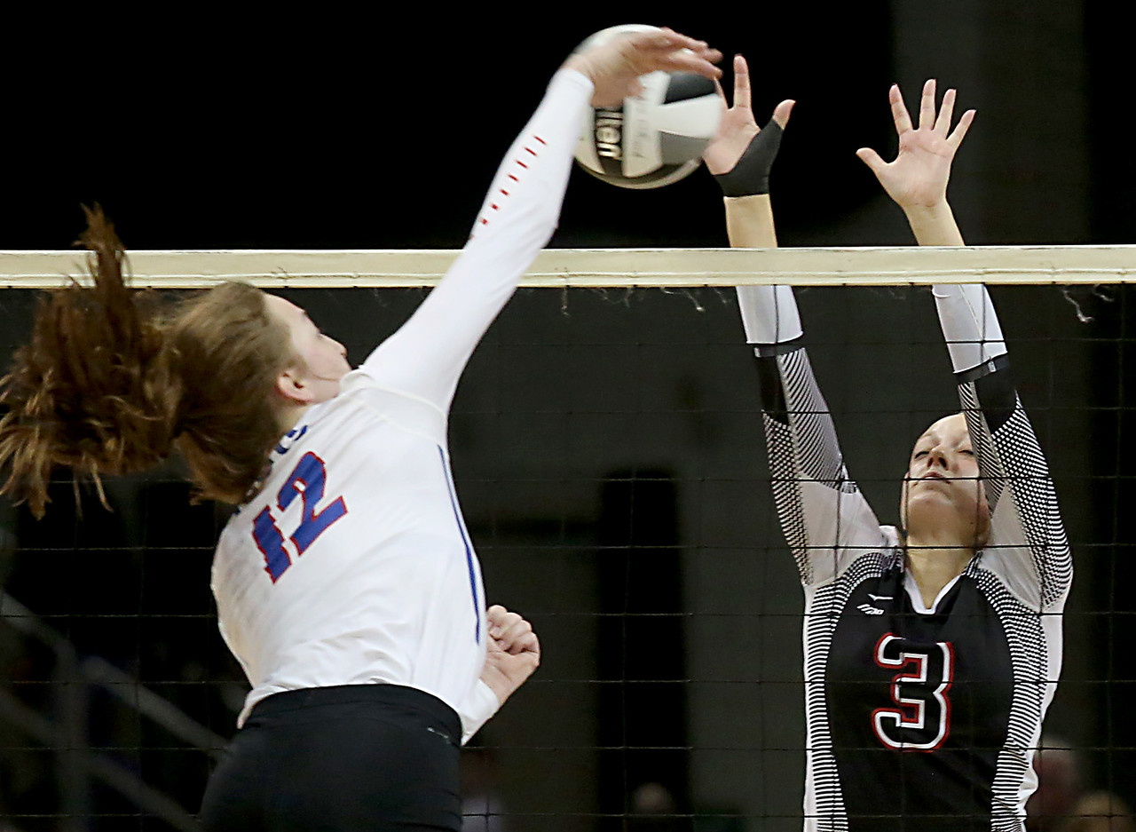 E.L. Hubbard / Special to GateHouse Ohio Media<br /> Zoarville Tuscarawas Valley (B) Clara Ackerman stops the spike attempt of Marengo Highland's Raina Terry during their Division III semifinal at Wright State's Nutter Center in Fairborn Friday, Nov. 11, 2016.