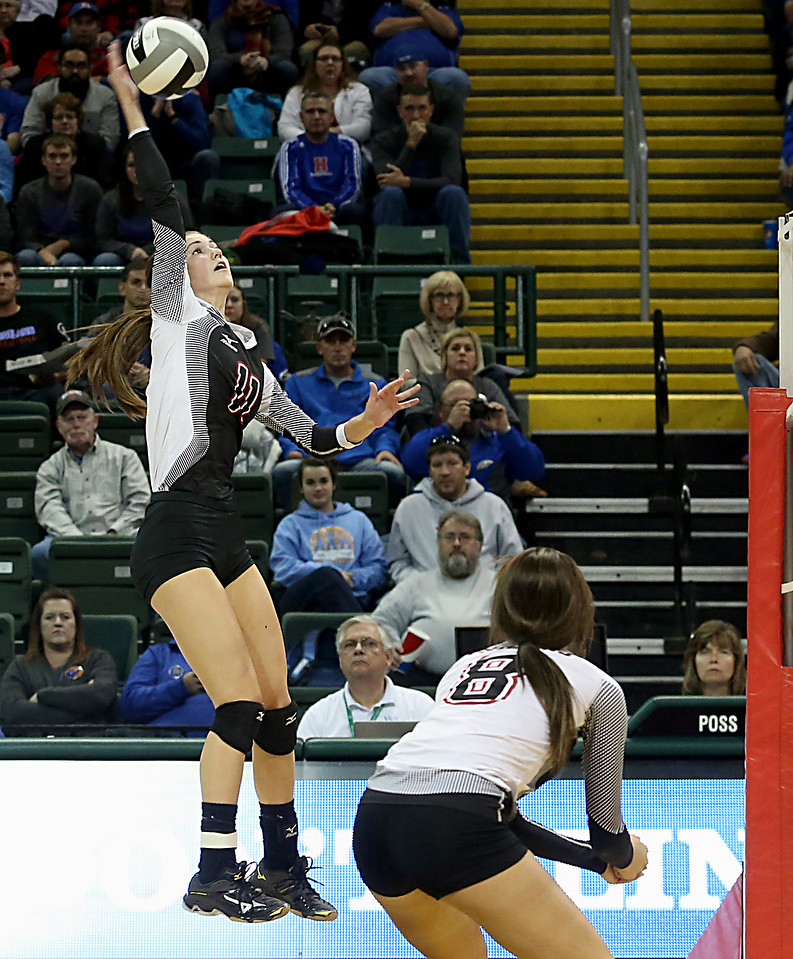 E.L. Hubbard / Special to GateHouse Ohio Media<br /> Zoarville Tuscarawas Valley (S) Samantha Pruett returns a volley to Marengo Highland during their Division III semifinal at Wright State's Nutter Center in Fairborn Friday, Nov. 11, 2016.