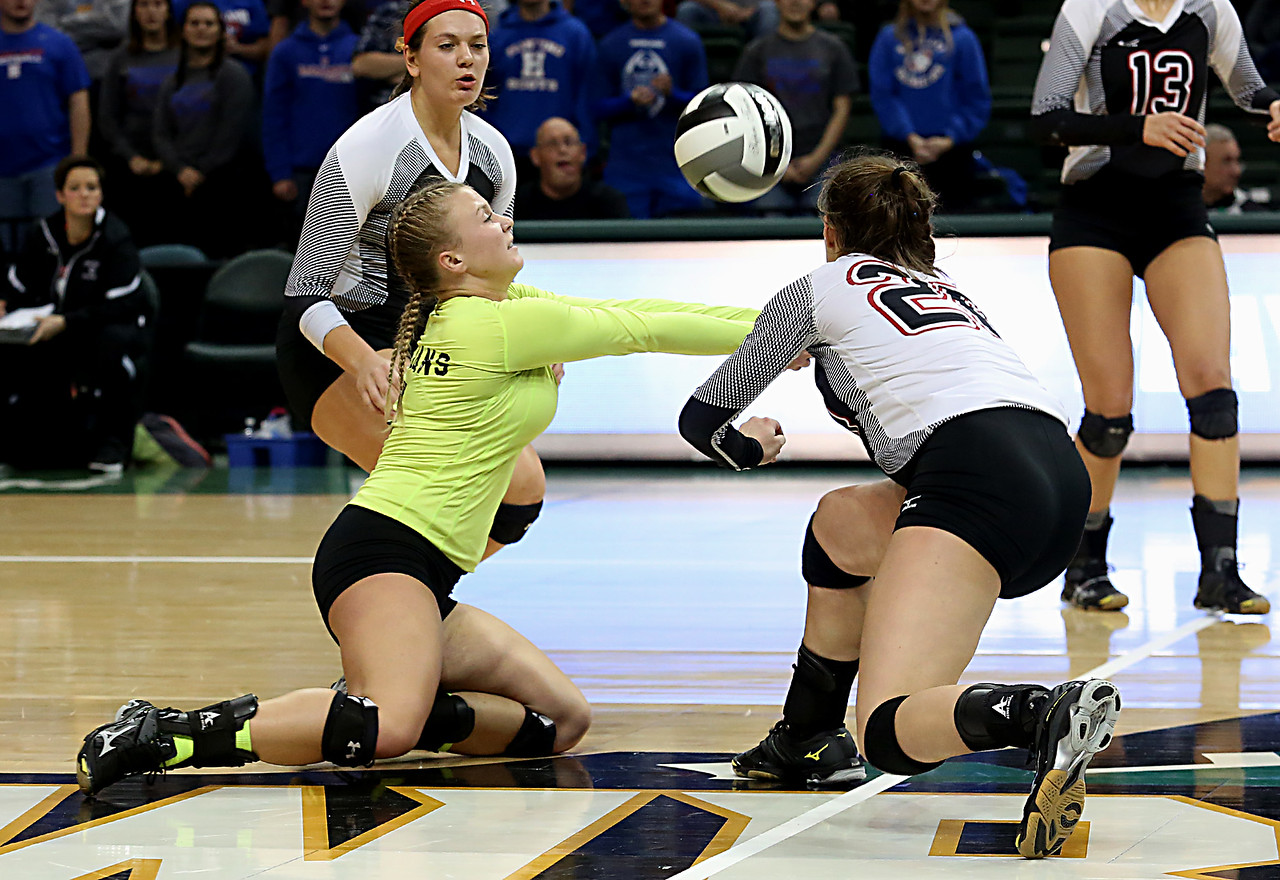 E.L. Hubbard / Special to GateHouse Ohio Media<br /> Zoarville Tuscarawas Valley's Jenna Franks and Sage Peters converge on a Marengo Highland serve during their Division III semifinal at Wright State's Nutter Center in Fairborn Friday, Nov. 11, 2016.