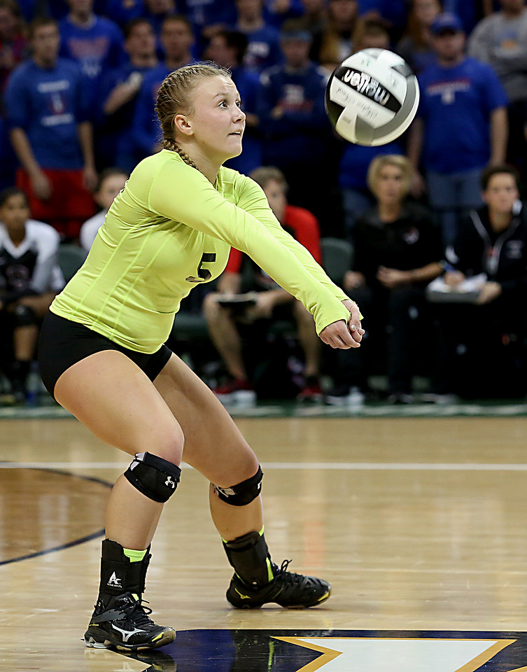 E.L. Hubbard / Special to GateHouse Ohio Media<br /> Zoarville Tuscarawas Valley (L) Jenna Franks returns a volley to Marengo Highland during their Division III semifinal at Wright State's Nutter Center in Fairborn Friday, Nov. 11, 2016.