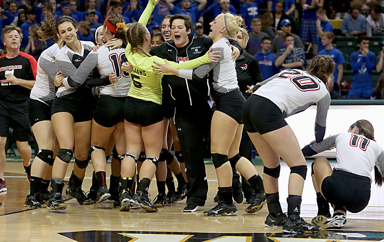 E.L. Hubbard / Special to GateHouse Ohio Media<br /> The Zoarville Tuscarawas Valley Trojans celebrate their win over Marengo Highland in their Division III semifinal at Wright State's Nutter Center in Fairborn Friday, Nov. 11, 2016.