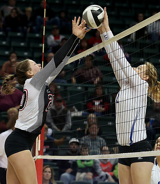 E.L. Hubbard / Special to GateHouse Ohio Media<br /> Zoarville Tuscarawas Valley's Sage Peters and Casstown Miami East's Reagan Morrett meet at the net during their Division III State Championship game at Wright State's Nutter Center in Fairborn Saturday, Nov. 12, 2016.