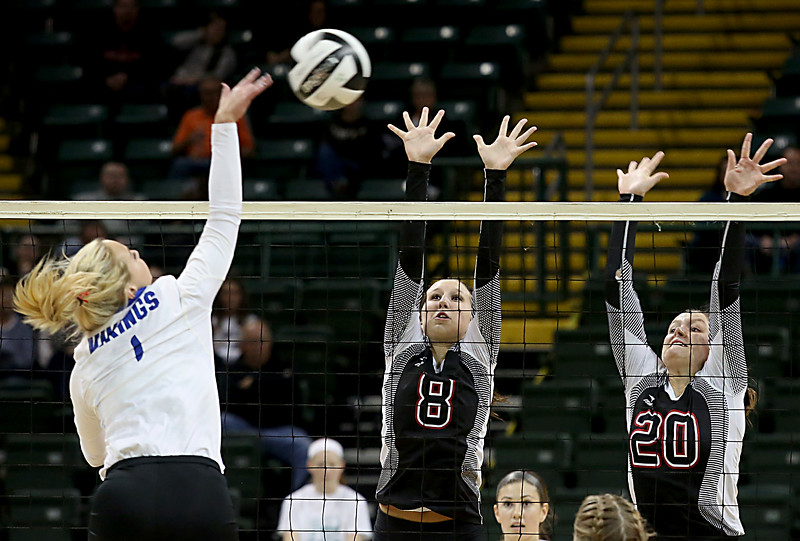 E.L. Hubbard / Special to GateHouse Ohio Media<br /> Zoarville Tuscarawas Valley's Jadyn Kuykendall and Sage Peters try to block the shot of Casstown Miami East's Taylor McCuistion during their Division III State Championship game at Wright State's Nutter Center in Fairborn Saturday, Nov. 12, 2016.