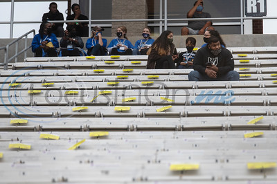 Yellow signs mark off seats to encourage social distancing between fans in the stands of The Tyler High School football season home opener at Christus Trinity Frances Rose Stadium against Texas High School on Thursday, Sept. 24, 2020. The season was delayed a month for District 6A schools due to the coronavirus pandemic. The stadium was sold out at reduced capacity.