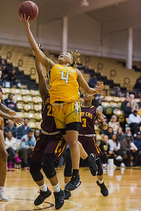 Tyler Junior College's Kharisima Brown (4) goes up for a shot above a Bossier Parish defender during game action Wednesday, Jan. 5, 2020, a Wagstaff Gym in Tyler. (Cara Campbell/Tyler Morning Telegraph)