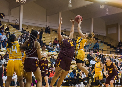 Tyler Junior College's Kharisima Brown (4) attempts a shot above Bossier Parish defender Chasidy Ross (52) during game action Wednesday, Jan. 5, 2020, a Wagstaff Gym in Tyler. (Cara Campbell/Tyler Morning Telegraph)