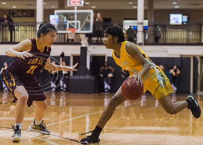 Tyler Junior College's Akeria James (5) dribbles the ball in front of Bossier Parish defender Elna Guardiola (21) during game action Wednesday, Jan. 5, 2020, a Wagstaff Gym in Tyler. (Cara Campbell/Tyler Morning Telegraph)