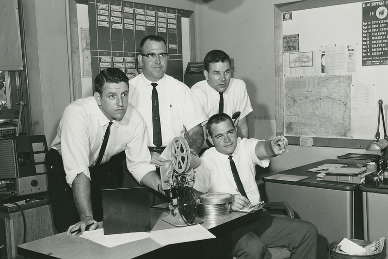 1963 University at Buffalo football coaching staff.  (Left to Right) Ron LaRocque, Buddy Ryan, Robert Deming, Michael Rhodes (seated).