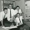 1963 University at Buffalo football coaching staff.  (Left to Right) Ron LaRocque, Buddy Ryan, Robert Deming, Michael Rhodes (seated).