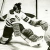 Buffalo goalie Mike Dunn deflects a sot by a Queens College Player, University at Buffalo hockey, 1970-71.