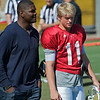 Keyshawn Johnson (USC All-American Wide Receiver; 11 years in the NFL and now a TV Sports Announcer) and Jerry Neuheisel (son of former UCLA Coach, RIck Neuheisel) and Walk-on Freshman QB.