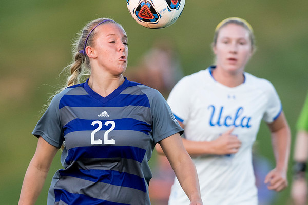 Weber State's Kinsey Napoli (22) heads the ball as UCLA defender Delanie Sheehan (17 right) chases her down. On September 3, 2017, at the Wildcat Soccer Field in Ogden.