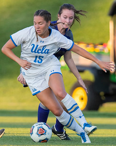 MacKenzie Cerda (15) of UCLA tries to get around the Weber defender Katie Allen (30) On September 3, 2017, at the Wildcat Soccer Field in Ogden.