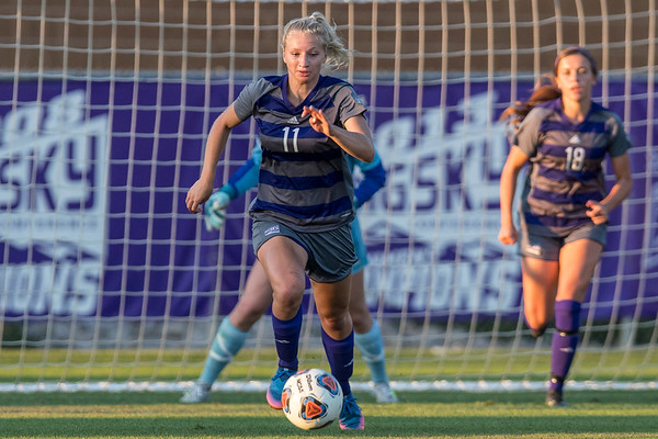 Gabrielle Vivier-Hannay (11) tries to get the ball out of the Weber State goal area against UCLA at the Wildcat Soccer Field in Ogden, on September 3, 2017.