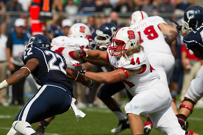 East Hartford CT Sept. 8 2012 Rentschler Field North Carolina State  fullback  44  Logan Winkles blocks UCONN Huskies  Safety  22  Andrew Adams