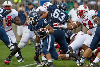 East Hartford CT Sept. 8 2012 Rentschler Field UCONN Huskies  Running Back  43  Lyle McCombs breaks through North Carolina State  linebacker  34  Rickey Dowdy on his way to scoring UConn's only touchdown