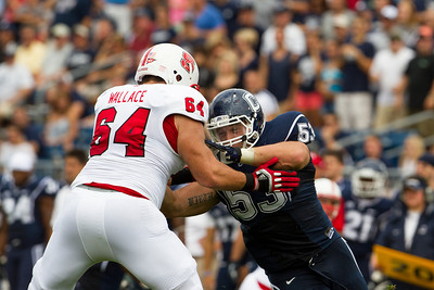 East Hartford CT Sept. 8 2012 Rentschler Field UCONN Huskies  Defensive Tackle  53  Ryan Wirth gets block by North Carolina State  offensive guard  64  Andrew Wallace