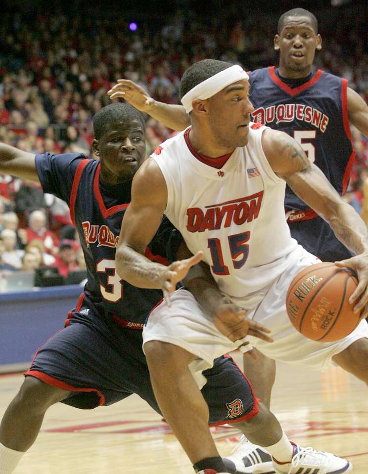 E.L. Hubbard for the DDN<br /> UD forward Charles Little tries to avoid Duquesne guard Eric Evans in the first half at UD Arena Saturday, March 7, 2009.