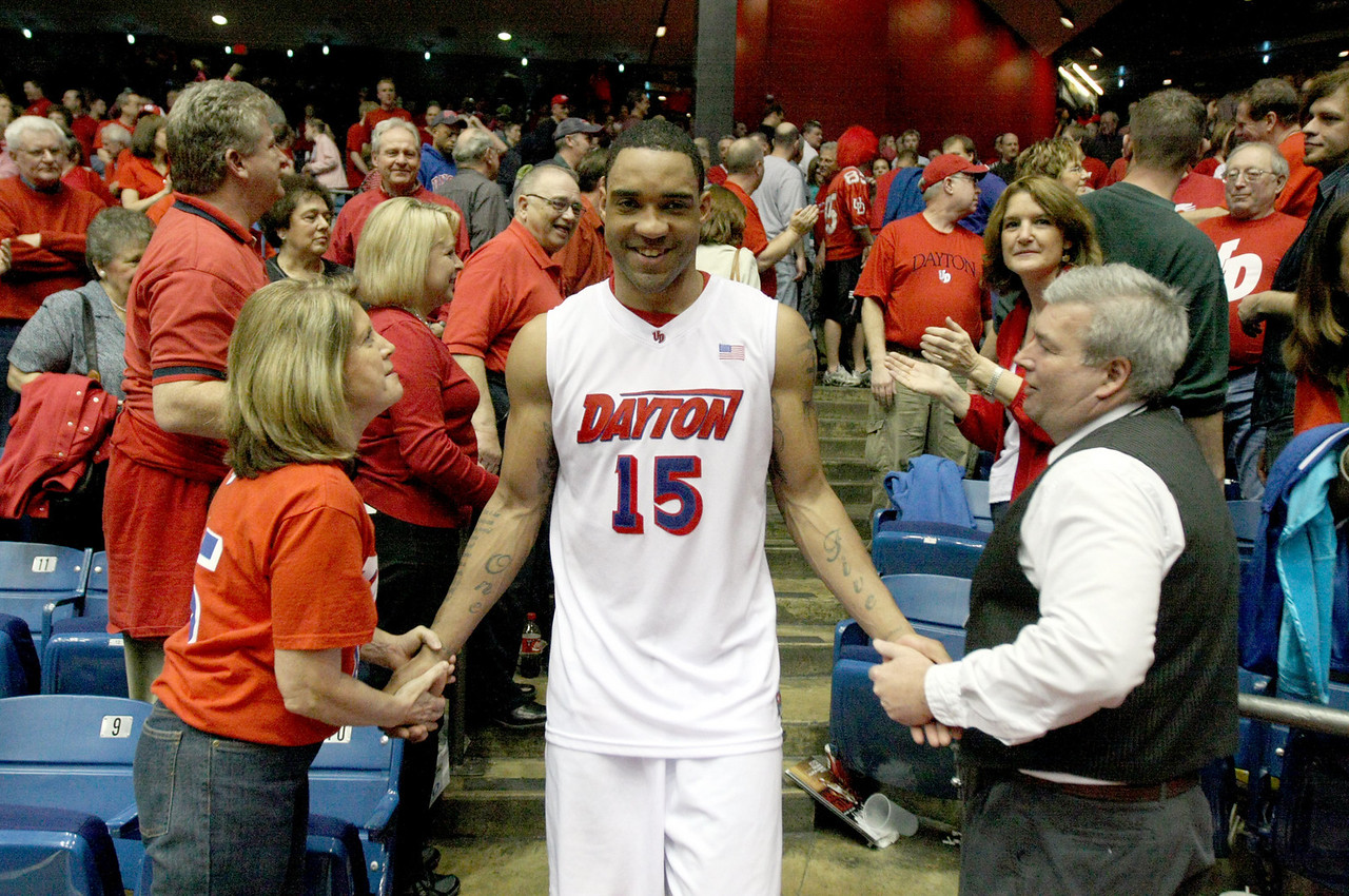 E.L. Hubbard for the DDN<br /> UD senior Charles Little is congratulated by the fans after he and his teammates made the rounds through the stands at UD Arena Saturday, March 7, 2009. UD defeated Duquesne to go undefeated at home, and also set a season attendance mark.