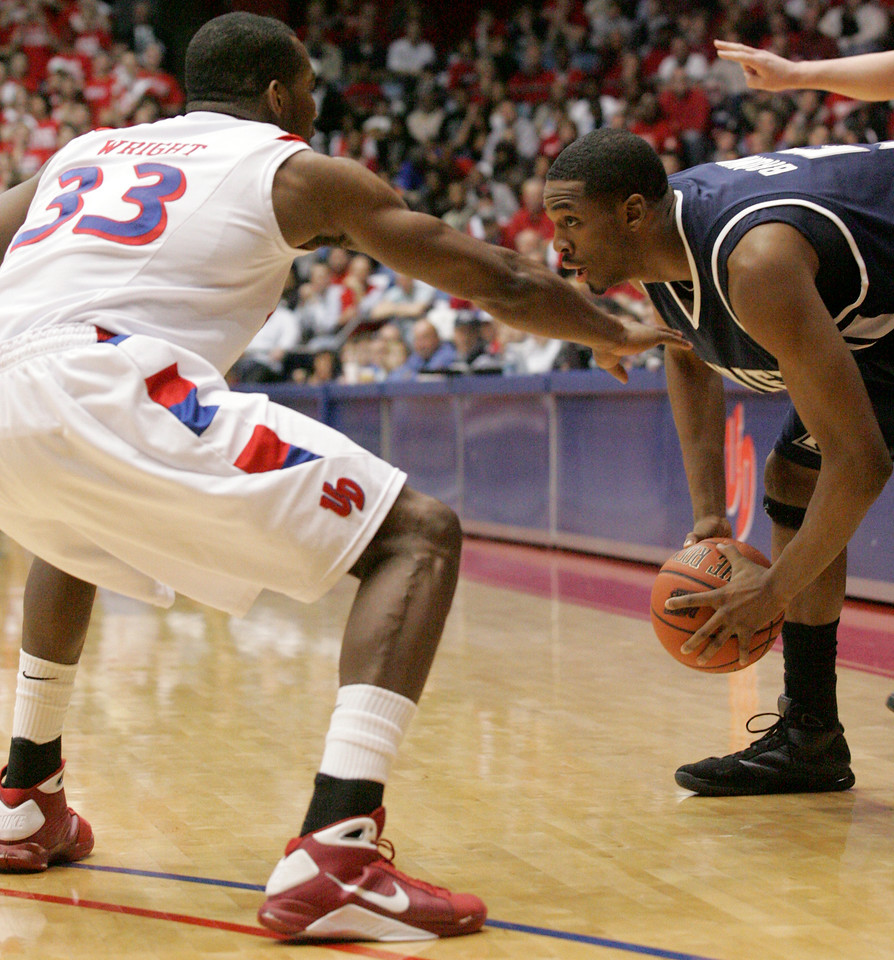 E.L. Hubbard for the DDN<br /> Dayton forward Chris Wright, a Trotwood Madison grad, and Xavier forward Derrick Brown, a CJ grad, in action at UD Arena Wednesday, February 11, 2009.