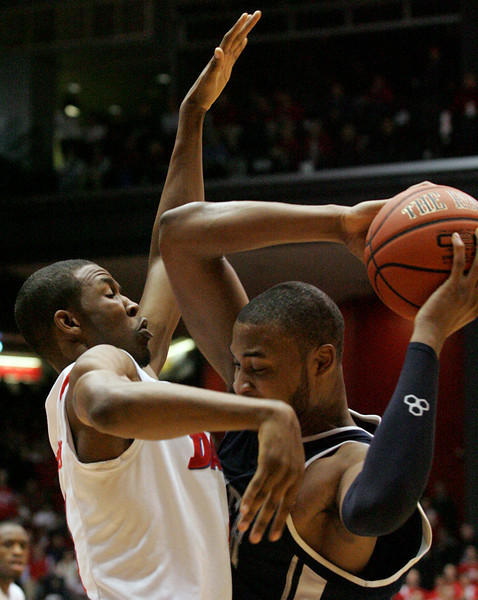 E.L. Hubbard for the DDN<br /> Dayton guard/forward Chris Johnson prevents Xavier forward/center Jason Love from shooting in the first half at UD Arena Wednesday, February 11, 2009.