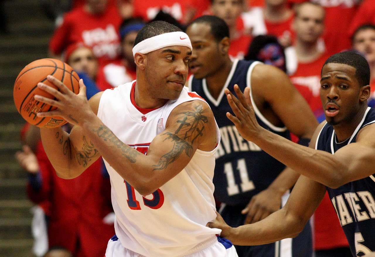 E.L. Hubbard for the DDN<br /> Dayton forward Charles Little is guarded by Xavier forward Derrick Brown in the first half at UD Arena Wednesday, February 11, 2009.