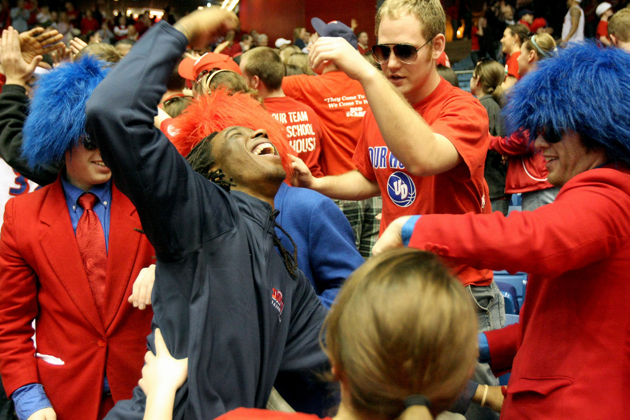 E.L. Hubbard for the DDN<br /> Injured UD player Rob Lowery, in blue jacket, celebrates with the fans after UD defeated Duquesne to go undefeated at home Saturday, March 7, 2009. The home attendance for the season also set a record.