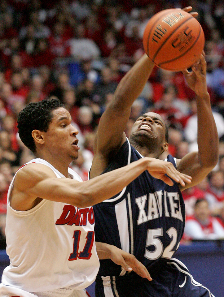 E.L. Hubbard for the DDN<br /> Dayton guard Stephen Thomas stops Xavier guard Terrell Holloway under the Xavier basket and makes the steal in the closing minutes at UD Arena Wednesday, February 11, 2009.