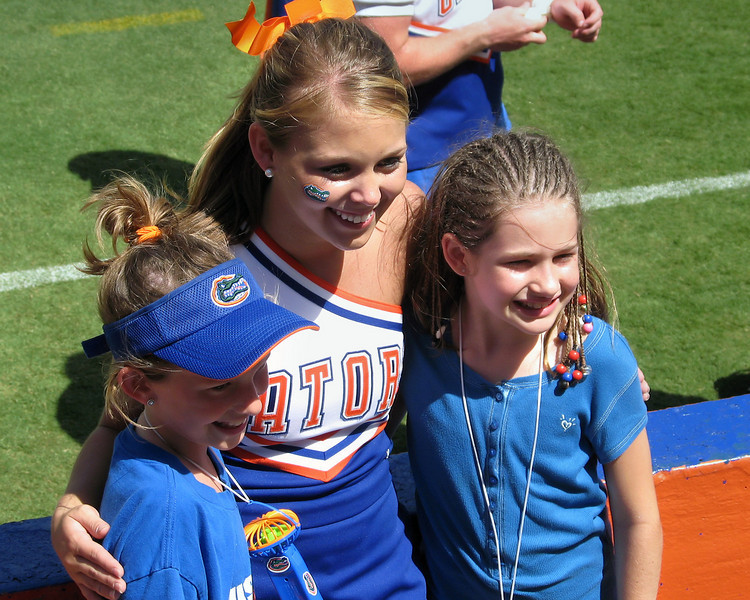 University of Florida cheerleader posing with fans after the Orange & Blue game, April  2008