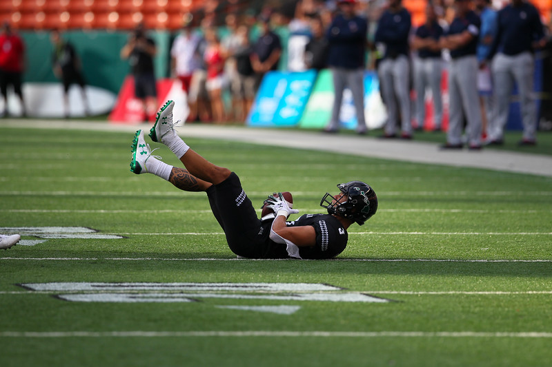 Hawaii wide receiver Jason-Matthew Sharsh catches a pass in the second quarter against Arizona at Aloha Stadium on August 24, 2019, in Honolulu, Hawaii.