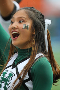 A Hawaii cheerleader encourages the crowd during the Rainbow Warriors game against the Arizona Wildcats at Aloha Stadium on August 24, 2019, in Honolulu, Hawaii. Hawaii won 45-38 over their foes from the Pac-12.