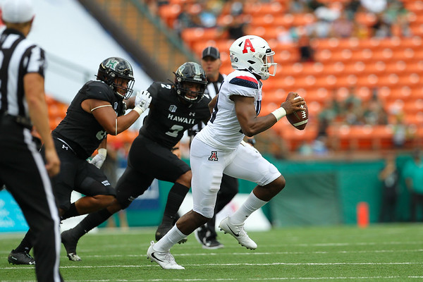 Arizona quarterback Khalil Tate scrambles from the Hawaii defense at Aloha Stadium on August 24, 2019, in Honolulu, Hawaii.