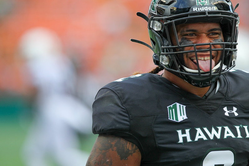 Hawaii linebacker Jeremiah Pritchard smiles at the Hawaii fans during a game against the Arizona Wildcats at Aloha Stadium on August 24, 2019, in Honolulu, Hawaii.