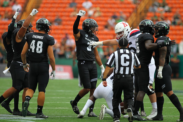 The Hawaii defense celebrates a third down stop against the Arizona Wildcats at Aloha Stadium on August 24, 2019, in Honolulu, Hawaii.