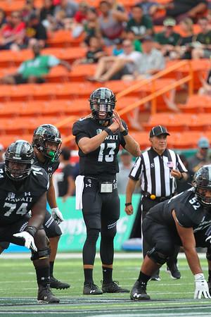 Hawaii quarterback Cole McDonald (13) surveys the defense before the snap against the Arizona Wildcats at Aloha Stadium on August 24, 2019, in Honolulu, Hawaii.