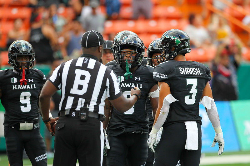 The back judge addresses the Hawaii receivers at Aloha Stadium on August 24, 2019, in Honolulu, Hawaii.