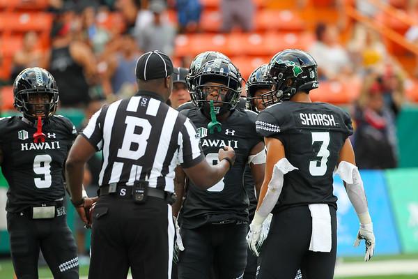 The back judge addresses the Hawaii receivers at Aloha Stadium on August 24, 2019, in Honolulu, Hawaii.